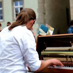 A pianist is playing in public